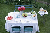 Table laid in garden for a summer party