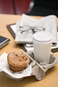 Muffin and cup of coffee in office
