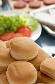 Hamburger buns, salad and burgers
