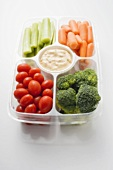 Assorted vegetables with dip in plastic tray