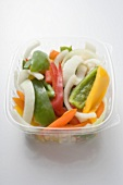 Sliced vegetables in opened plastic container