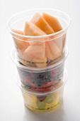 Fresh fruit in three plastic tubs