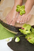 Woman enjoying a soothing foot bath