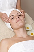 Woman having beauty treatment (face massage)
