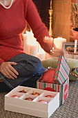 Woman opening boxes of Christmas decorations