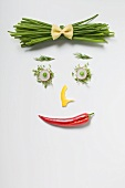 Woman's face made from vegetables, herbs & pasta bow tie