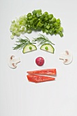 Amusing face made from vegetables, dill and mushrooms