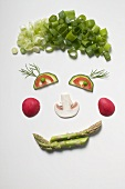 Amusing face made from vegetables, dill and mushroom