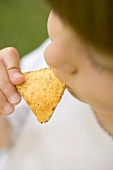 Child eating tortilla chip