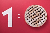 1:0 (Number 1 & Linzer torte, symbolising football score)