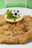 Wiener schnitzel (veal escalope) with football & football figures