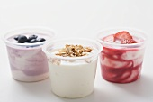 Three yoghurts with berries and cereal