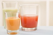 Three different juices in glasses