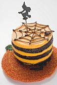 Pumpkin chocolate cake with witch for Halloween