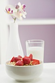 Strawberry muesli in white bowl