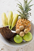 Bowl of exotic fruit, limes and coconut