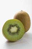 Whole kiwi fruit and half a kiwi fruit