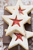 Jam-filled star biscuits with icing sugar (Christmas)