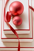 Red and white boxes, red Christmas baubles and ribbon
