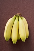 Bunch of bananas on brown background