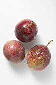 Three purple passion fruits
