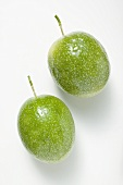 Two green passion fruits