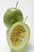 Green passion fruits, whole and half