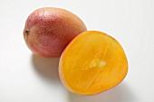 Whole mango and half a mango