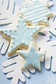 Three star biscuits with blue icing