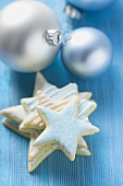 Iced star biscuits and silver Christmas tree baubles