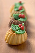 Small ring cakes with marzipan leaves for Christmas