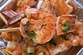 Salmon and prawn skewers with mint in aluminium dish