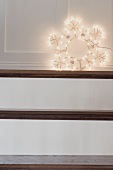 Christmas decoration: illuminated star on stairs