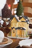 Weihnachtliche Tischdeko (beleuchtetes Haus)