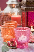 Middle Eastern decorations: windlights, roses, lantern, candles