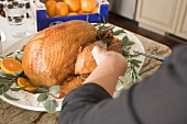 Garnishing roast turkey on platter