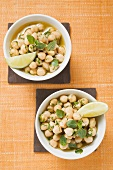 Chick-peas with lime wedges and herbs