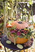 Pumpkin decorated with flowers on garden table