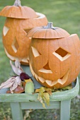 Carved pumpkin faces on garden table
