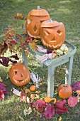 Autumnal garden decoration with pumpkins and leaves