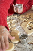 Child cutting out biscuits