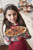 Girl holding freshly-baked fig tart