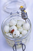 Marinated cheese balls in jar with mouse skewer