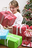 Girl with lots of Christmas gifts