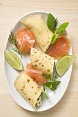Pancake with soft cheese, smoked salmon, herbs, lime