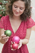 Woman holding Christmas baubles