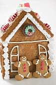 Gingerbread house with two gingerbread men