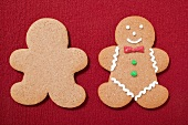 Two gingerbread men, plain and decorated