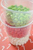 Jelly beans in plastic tubs (for Christmas)