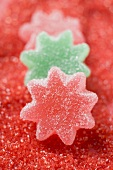 Jelly stars on red sugar